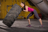 Strong girl flipping a tire — Stock Photo