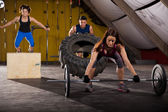 Cross-training in a gym — Stock Photo
