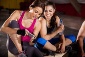 Social networking at a gym — Stock Photo