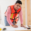 Handsome young contractor working on a remodeling design for a houseg a house — Stock Photo #47362437