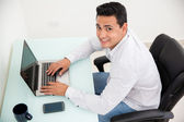 Happy man in an office — Stock Photo