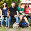 Happy students using technolgy — Stock Photo #48453845