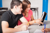 Teenagers using technology — Stock Photo