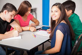 Group of teens studying together — Foto Stock
