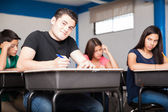 Happy student taking a test — Stock Photo