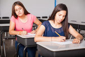 Girl cheating in a test — Stock Photo