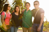 Happy teenagers at sunset — Stock Photo