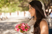 Bride holding rose bouquet — Stock Photo