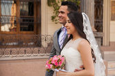 Bride and groom behind her — Stock Photo
