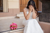 Bride crying outside church — Stock Photo