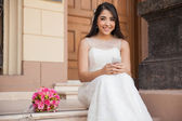 Pretty bride with cell phone — Stock Photo