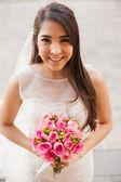 Happy Hispanic bride outdoors — Stock Photo