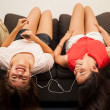 Girl and friend listening to music — Stock Photo #51468897