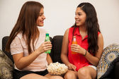 Friends drinking soda and eating popcorn — Stock Photo