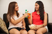 Friends clinking their bottles of soda — Stock Photo