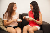 Teenager having some coffee with her friend — Stock Photo