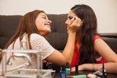 Teenagers wearing makeup — Stock Photo
