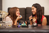 Friends putting some makeup — Stock Photo