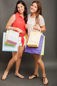 Teenagers carrying shopping bags — Foto de Stock