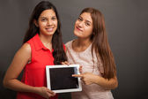 Teenagers promoting a tablet app — Stock Photo