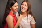 Teenagers singing with a microphone — Foto de Stock