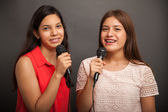 Teenagers singing with microphones — Stock Photo