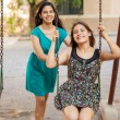 Friends playing in a swing — Stock Photo #51470583