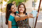 Friends taking a selfie with an instant camera — Stock Photo