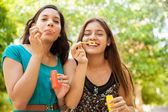 Friends acting all silly and blowing bubbles — Stock Photo