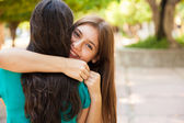 Teen hugging her best friend — Stock Photo