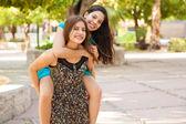 Teens piggyback riding — Stock Photo