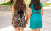 Friends holding hands at a park — Stock Photo