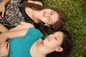Girls laying on the grass — Stock Photo