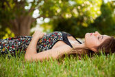 Gorgeous teen laying on the grass — Stock Photo