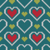Seamless knitted sweater pattern with hearts — Stock Vector