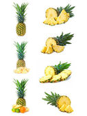 Set fresh pineapple fruits with cut isolated on white background — Stockfoto