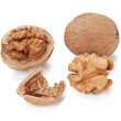 Walnut and a cracked walnuts isolated on the white background — Stock Photo