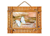 Bamboo photo frame with abstract composition of butterflies, bi — Stock Photo