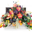 Colorful floral arrangement of roses, lilies, freesia and irises — Stock Photo