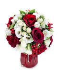 Colorful flower bouquet arrangement centerpiece in red vase isol — Stock Photo