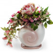 Colorful floral arrangement in a pink ceramic vase, isolated on — Stock Photo
