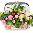 A colorful floral arrangement of roses and lilies in acardboard — Stock Photo
