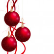 Christmas balls hanging with tapes isolated on white background — ストック写真
