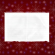Sheet of paper on abstract red background with snowflakes — Stockfoto