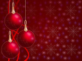 Christmas balls hanging with tapes on red background with snowfl — Stock Photo