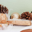 Abstract composition from birch logs, Christmas balls and cones — Stockfoto