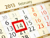 Calendar page with red frame on February 14 2013 — Stock Photo