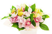 Colorful flower bouquet from orchids arrangement centerpiece in — Stock Photo