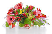 Colorful floral arrangement from lilies, cloves and orchids in c — Stock Photo