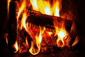 Fireplace with wood and fire — Stock Photo